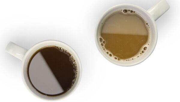 Kubki z gorącą kawą i herbatą - Sputnik Polska