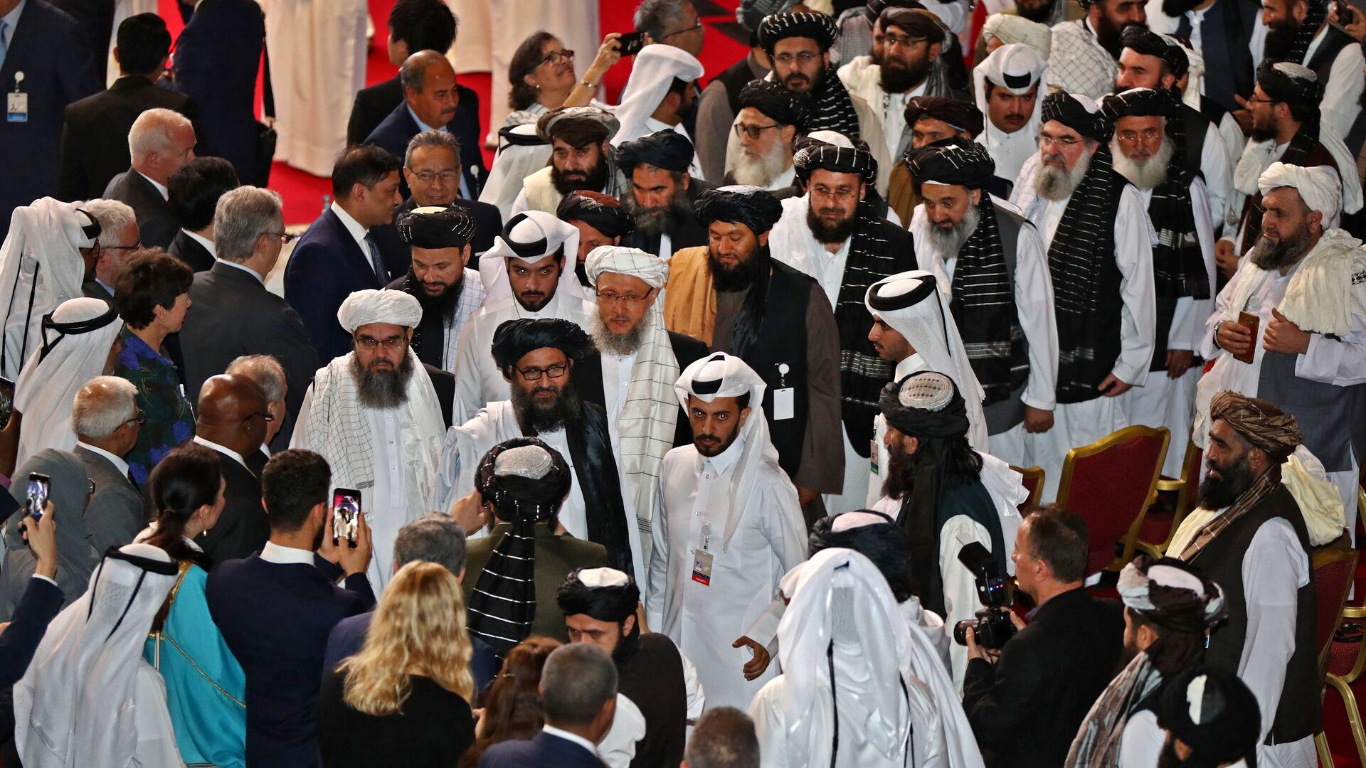 Talibowie na ceremonii podpisania porozumienia ze Stanami Zjednoczonymi w Katarze. - Sputnik Polska, 1920, 12.07.2021