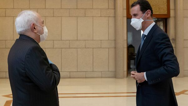 Prezydent Syrii Baszar al-Asad i szef MSZ Iranu Muhammad Dżawad Zarif - Sputnik Polska