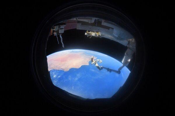 Zdjęcie Ziemi wykonane przez iluminator z MSK  - Sputnik Polska