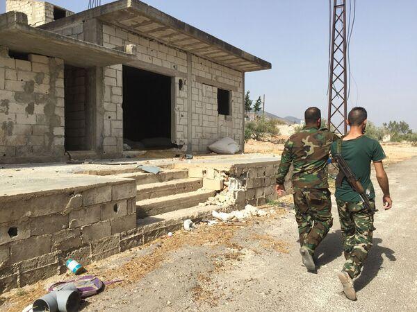 Żołnierze syryjskiej armii po wyzwoleniu miejscowości Saf-Safa (prowincja Hama) - Sputnik Polska