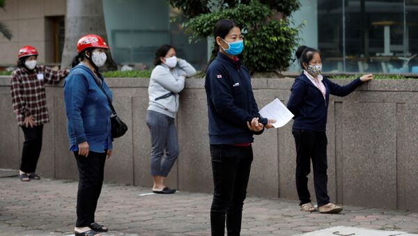Epidemia koronawirusa w Wietnamie. - Sputnik Polska