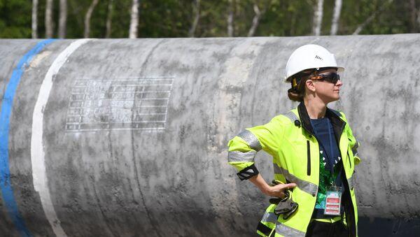 Kobieta przy budowie Nord Stream 2  - Sputnik Polska