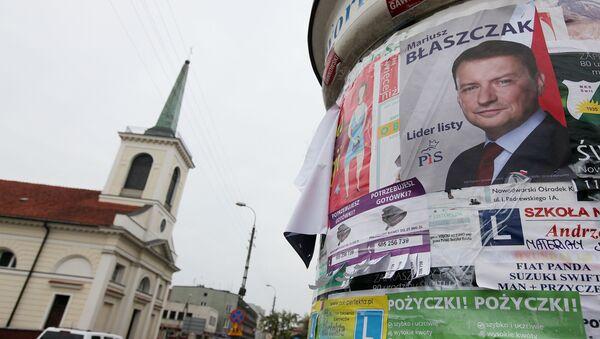 Plakat wyborczy przewodniczącego klubu parlamentarnego Prawa i Sprawiedliwości Mariusza Błaszczaka na ulicy Warszawy - Sputnik Polska