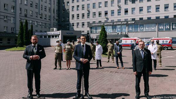 Konferencja prasowa premiera Morawieckiego, szefa MZ i szefa MSWiA - Sputnik Polska