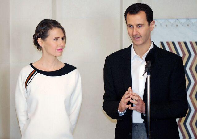 Prezydent Syrii Baszar al-Asad z żoną Asmą