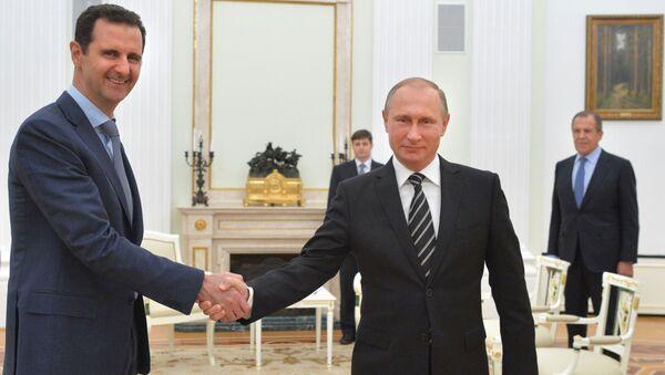 Prezydent Syrii Baszar al-Asad i prezydent Rosji Władimir Putin na spotkaniu w Kremlu - Sputnik Polska