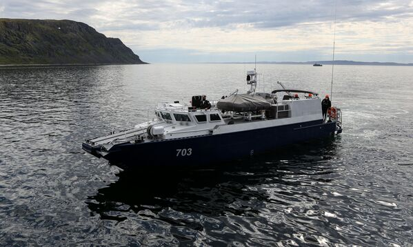 Taktyczne ćwiczenia sił poszukiwawczo-ratowniczych Floty Północnej Rosji na Morzu Barentsa - Sputnik Polska