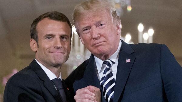 Prezydenci USA i Francji, Donald Trump i Emmanuel Macron. - Sputnik Polska