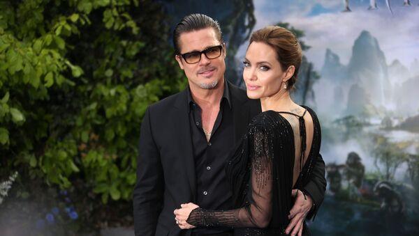 Brad Pitt i Angelina Jolie w 2014 roku - Sputnik Polska