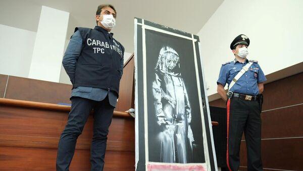 Karabinierzy z rysunkiem Banksy'ego - Sputnik Polska