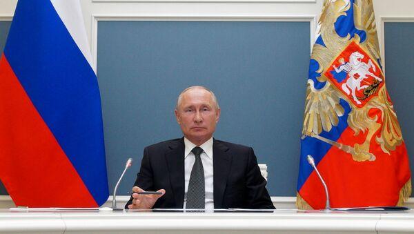 Prezydent Rosji Władimir Putin w czasie wideokonferencji - Sputnik Polska