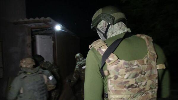 Funkcjonariusze FSB Rosji w czasie zatrzymania uczestników międzynarodowej organizacji terrorystycznej Hizb at-Tahrir  - Sputnik Polska