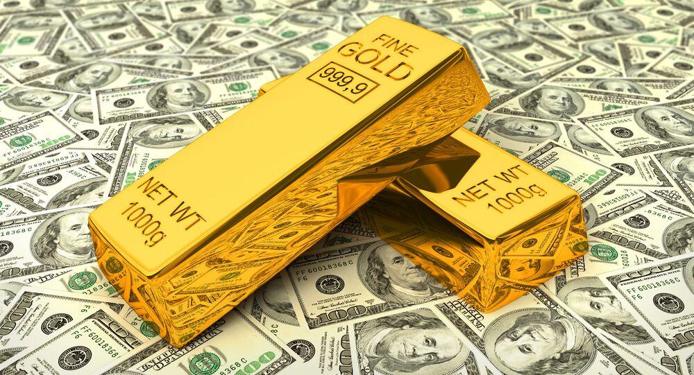 Sztabki złota na dolarach