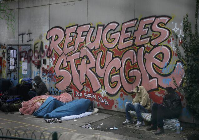 Migranci na ulicach Paryża