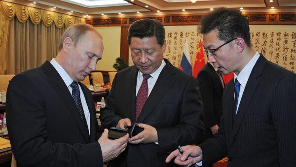 Prezydent Rosji Władimir Putin i przewodniczący ChRL Xi Jinping w Chinach - Sputnik Polska