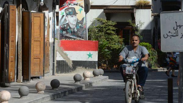 Mieszkaniec na jednej z ulic Damaszku - Sputnik Polska