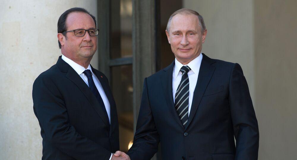 Prezydent Rosji Władimir Putin i Prezydent Francji Francois Hollande na spotkaniu w Paryżu