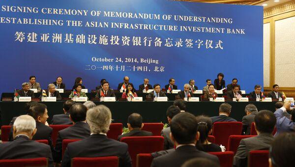 Delegaci na uroczystym podpisaniu aktu powołania Azjatyckiego Banku Inwestycji Infrastrukturalnych w Pekinie - Sputnik Polska
