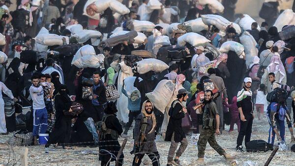 Syryjscy uchodźcy na syryjsko-tureckiej granicy - Sputnik Polska
