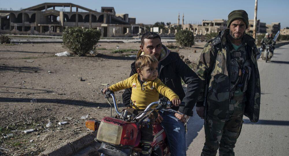 Mieszkańcy wsi w północno-wschodniej Syrii