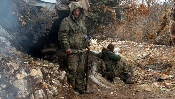 Oddział bojowników syryjskiego ruchu powstańczego po wypełnieniu zadania bojowego na północy Latakii - Sputnik Polska