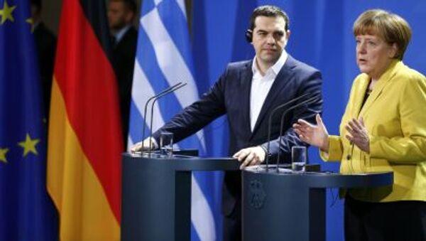 Premier Grecji Aleksis Tsipras i kanclerz Niemiec Angela Merkel - Sputnik Polska