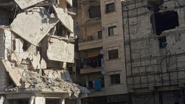 Uszkodzony budynek w syryjskim mieście Aleppo - Sputnik Polska