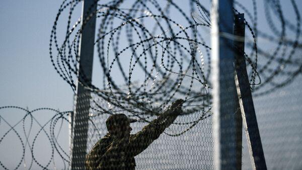 Ogrodzenie na grecko-macedońskiej granicy - Sputnik Polska
