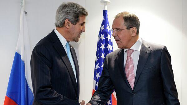 Sekretarz stanu USA John Kerry i rosyjski minister spraw zagranicznych Siergiej Ławrow - Sputnik Polska