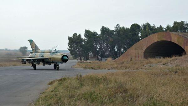 Samolot MiG-21 syryjskich sił powietrznych w bazie lotniczej Hama - Sputnik Polska