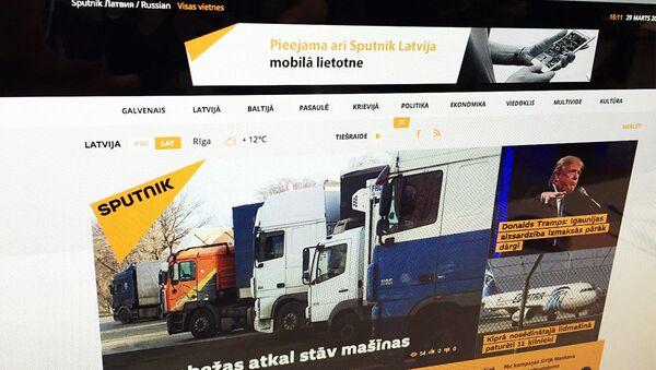 Strona multimedialnej agencji Sputnik w języku łotewskim - Sputnik Polska