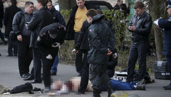 Policja na miejscu zabójstwa ukraińskiego dziennikarza Ołesia Buziny - Sputnik Polska