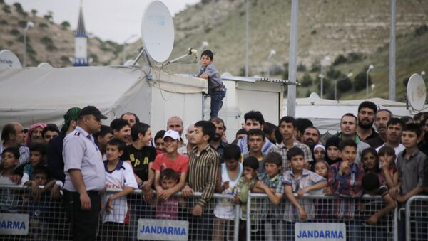 Uchodźcy w obozie na granicy turecko-syryjskiej - Sputnik Polska