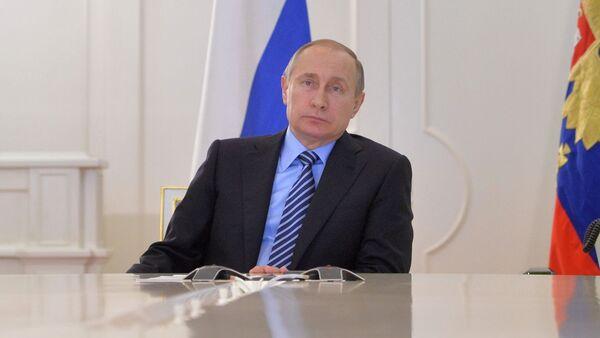 Władimir Putin w czasie wideokonferencji. Kreml. - Sputnik Polska