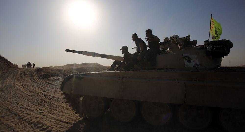 Iraccy żołnierze na drodze do Faludży