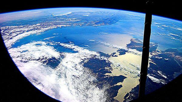 Ziemia sfotografowana przez kosmonautę Jurija Malenczenko - Sputnik Polska