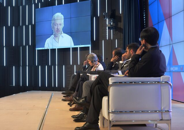 A video link up with Julian Assange, journalist, founder and editor-in-chief of WikiLeaks, at the session, End of the Monopoly: The Open Information Age, held as part of the New Era of Journalism: Farewell to Mainstream international media forum at the Rossiya Segodnya International Multimedia Press Center.