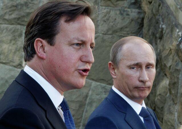 Brytyjski premier David Cameron i prezydent Rosji Władimir Putin