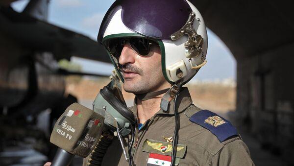 Pilot syryjskich sił powietrznych w bazie Hmeimim - Sputnik Polska