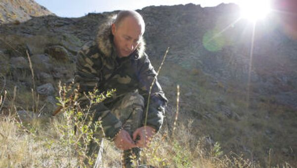 Władimir Putin w kamuflażu - Sputnik Polska