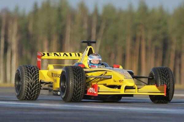 Władimir Putin w roli kierowcy Formuły-1 - Sputnik Polska