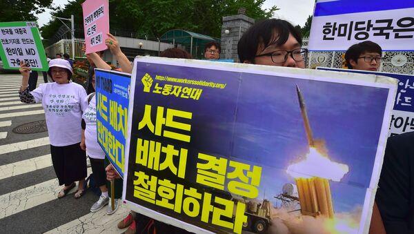 Protesty w Seulu przeciw rozmieszczeniu THAAD w Korei Południowej - Sputnik Polska