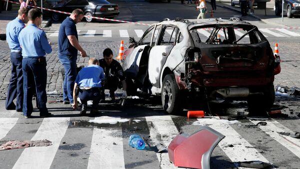 Policja na miejscu zabójstwa dziennikarza Pawła Szeremeta w centrum Kijowa. - Sputnik Polska