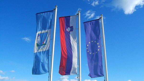 Flagi Słowenii i UE - Sputnik Polska