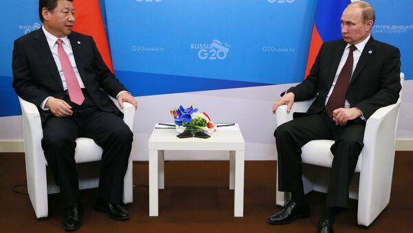Dwustronne spotkanie Władimira Putina z Xi Jinpingiem - Sputnik Polska