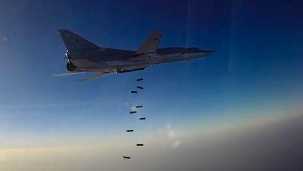 Nalot samolotu TU-22M3 na pozycje terrorystów w Syrii - Sputnik Polska