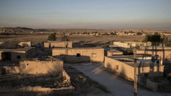 Jedna z wiosek w prowincji Al-Hasaka, z której wyparto dżihadystów z Państwa Islamskiego - Sputnik Polska