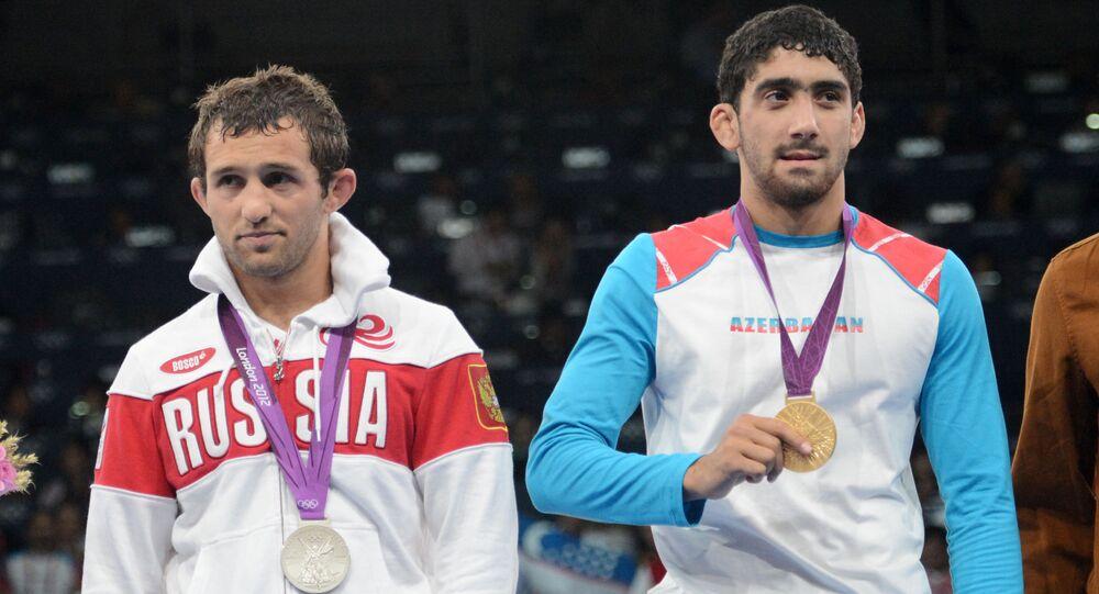 Besik Kuduchow (srebro) i Yogeshwar Dutt (brąz) na Igrzyskach Olimpijskich w Londynie w 2012 roku