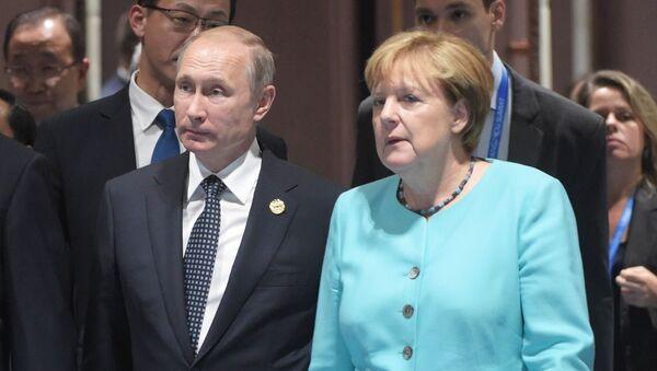 Przewodniczący ChRL Xi Jinping, prezydent Rosji Władimir Putin i kanclerz Niemiec Angela Merkel na szczycie G20 w chińskim Hangzhou - Sputnik Polska